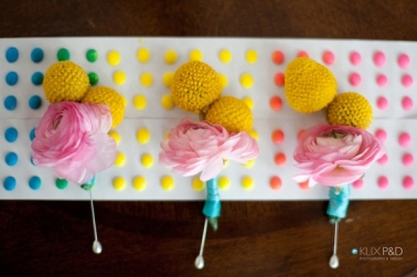 Boutonnieres of crespedia + ranunculus -- my faves!
